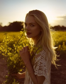 jpeg image of a model in canola fields